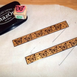 A butterfly design is stamped onto two brass blanks and I've used a Sharpie to give the bracelets a border and add some polka dots.